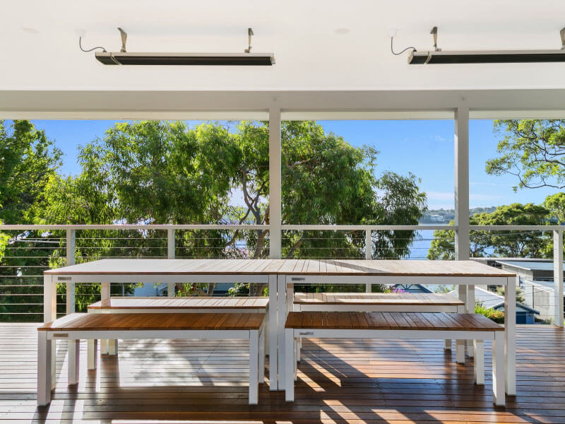 Loftus Bundeena Accommodation - View from inside to veranda and water